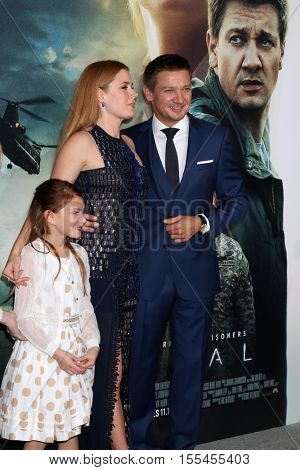 LOS ANGELES - NOV 6:  Abigail Pniowsky, Amy Adams, Jeremy Renner at the