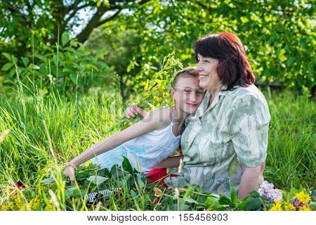 Granny with her granddaughter in the garden