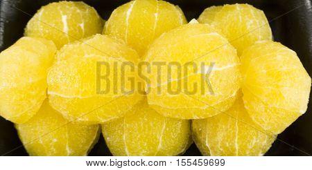Slices of fresh orange fruit in plate on white background