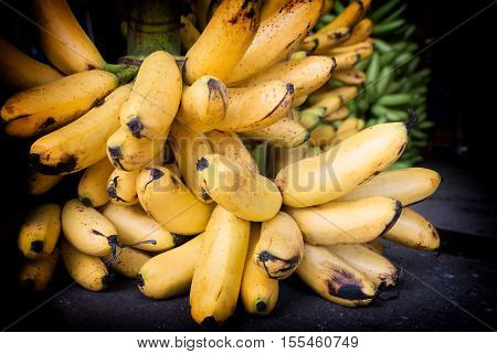 ripe yellow banana bunch on the floor in market