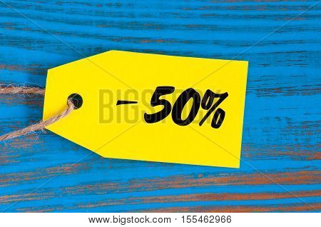sale minus 50 percent. Big sales fifty percents on blue wooden background for flyer, poster, shopping, sign, discount, marketing, selling, banner, web or header.