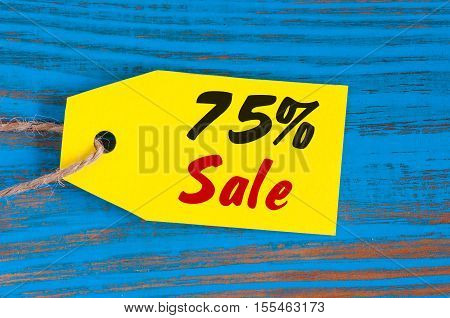sale minus 75 percent. Big sales seventy five percents on blue wooden background for flyer, poster, shopping, sign, discount, marketing, selling, banner, web