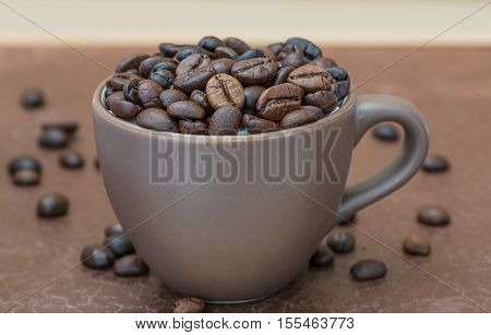 Roasted Coffee Beans  In Brown Coffee Cup