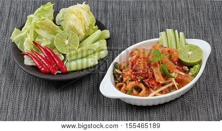 Spicy And Sour Mixed Herb Salad With Pork Skin And Pork Rind  Served .