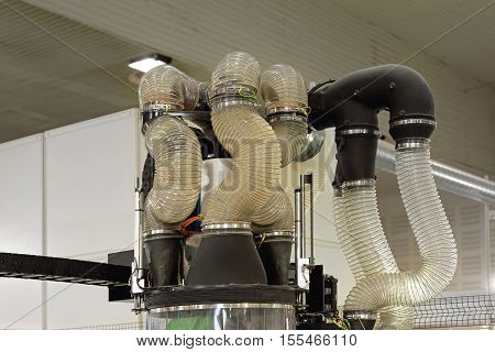 Hose and Pipes at Automated Machine in Wood Workshop