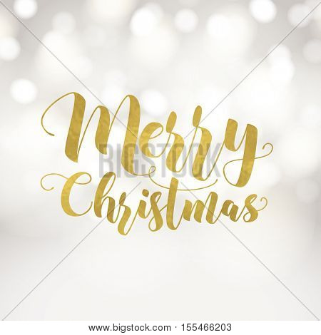 Merry Christmas greeting card. Typographic vector design, gold foil effect, beautiful light bokeh background, festive lights.