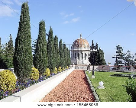 Alley of cypresses and Golden dome in Bahai Gardens in Haifa Israel