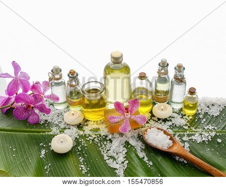 Spa setting on banana leaf with pink orchid ,candle, salt