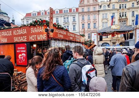 PRAGUE, CZECH REPUBLIC - December 24, 2014 : Tourists on foot Street in old town PRAGUE in Czech Republic