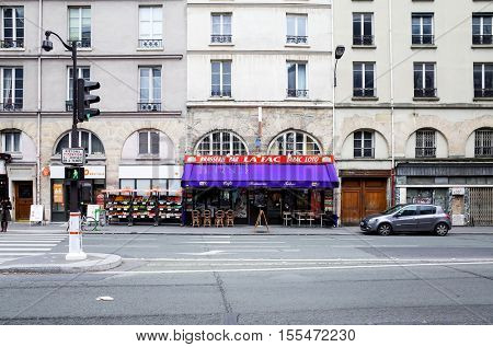 PARIS, FRANCE - February 19 : beautiful Street view of  Buildings around Paris city. Paris is the capital and most populous city of France. February 19, 2014, Paris, France.