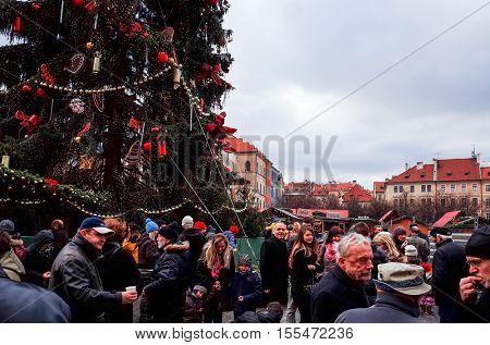 PRAGUE, CZECH REPUBLIC - December 24, 2014 : Tourists on foot Street in old town PRAGUE in Czech Republic