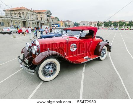 Padua, Italy - September 19, 2014: Benefit Antique Classic Car Show: People visiting and taking pictures of cars at Benefit Antique Classic Car Show at Padua at September 19, 2014. Cars and enthusiasts from all over Italy.