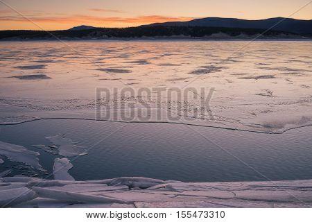 Winter landscape of Abraham Lake at sunrise.