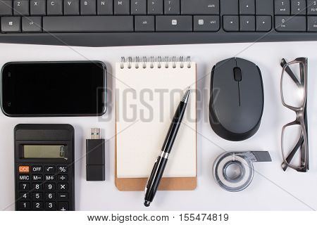 Office Supplies, Computer Devices And Notebook With Pen On Workplace Isolated On White Background. B