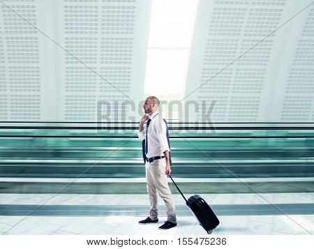 Businessman walking with trolley at the airport