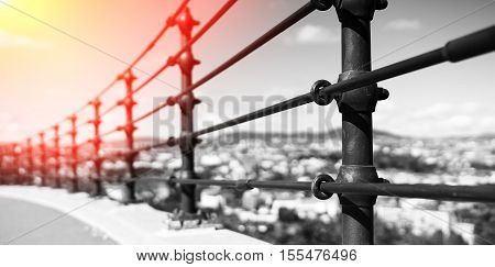 Black and white steel border fence with light leak background hd