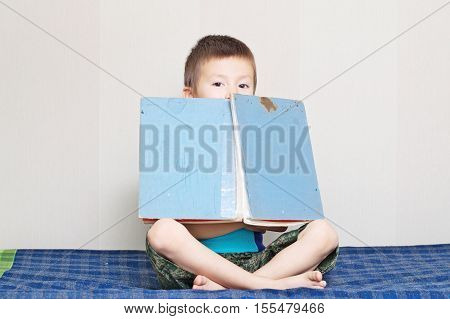 Boy with old fairy tale vintage book