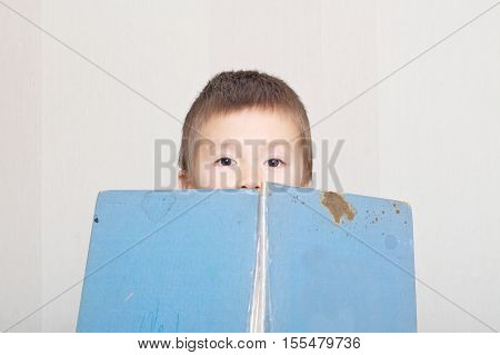 Boy peep out from book vintage and old book