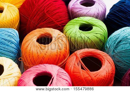 Colorful yarn of balls background. Bright knitting thread texture. Handiwork, leisure, hobby concept