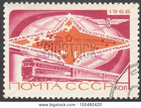 MOSCOW RUSSIA - CIRCA OCTOBER 2016: a post stamp printed in the USSR shows an electric train and map the series