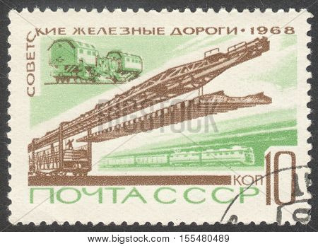 MOSCOW RUSSIA - CIRCA OCTOBER 2016: a post stamp printed in the USSR shows a track-laying train the series