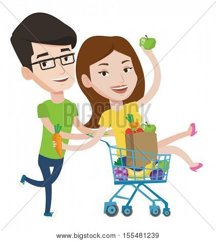 Couple of friends having fun while riding in shopping trolley. Happy man pushing a shopping trolley with his girlfriend and healthy food. Vector flat design illustration isolated on white background.