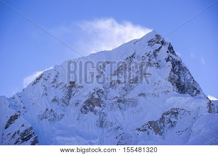 closed up view of Lhotse peak with snow blowing on top from Gorak Shep. During the way to Everest base camp. Sagarmatha national park. Nepal.