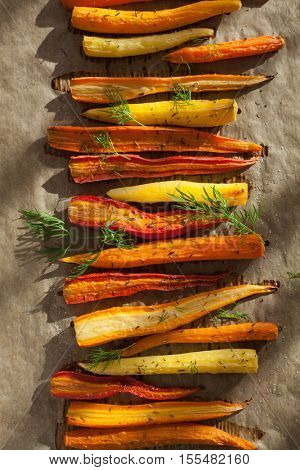 roasted colorful carrots on baking sheet