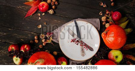 Pumpkins, Apples  And Nuts On  Rustic Wooden Background.