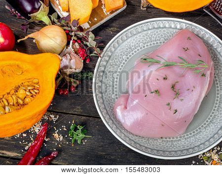 Raw Turkey Breast And Vegetables