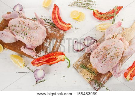Whole Raw Chicken With Spices And Herbs On Wooden Table.