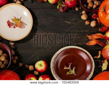 Autumn Table Setting With Pumpkins, Nuts And Apples.