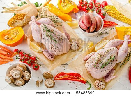Raw Chicken With Vegetables And Spices On A Wooden Board.