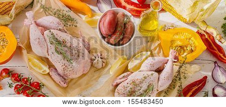 Raw Chicken With Vegetables On A White Wooden Board.