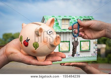 Real Estate Agent Giving House Key And Model House