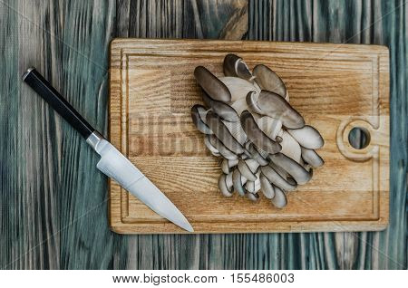 oyster mushrooms, cutting and cooking in the kitchen closeup