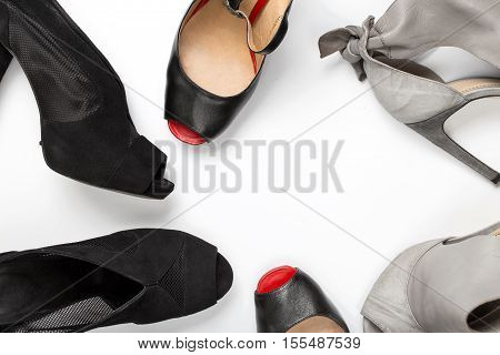 Frame of female shoes on white background top view