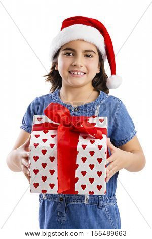 Young girl holding a a Christmas present