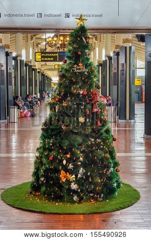 Jakarta, Indonesia - Dec 28, 2015: Christmas tree in Soekarno-Hatta International Airport. Interior of Domestic terminal departure area
