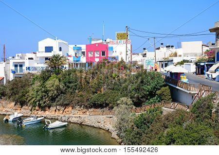 SISSI, CRETE - SEPTEMBER 14, 2016 - Small boats moored in a small bay off the harbour with town buildings to the rear Sissi Crete Greece Europe, September 14, 2016.