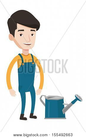 A happy farmer standing near a watering can. Young caucasian farmer using a watering can. Vector flat design illustration isolated on white background.