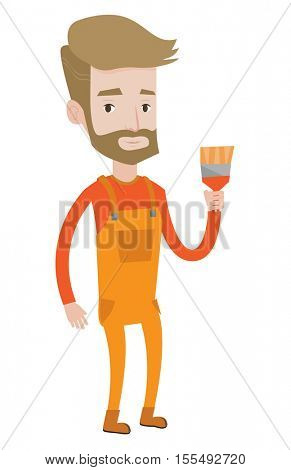 Hipster painter with the beard holding a paintbrush. Caucasian painter standing with a paintbrush in hand. Young painter in overalls. Vector flat design illustration isolated on white background.