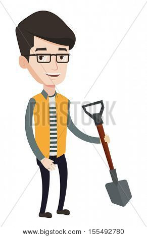 Young farmer standing with a shovel. Smiling caucasian farmer holding a shovel in hand. Farmer with a shovel is going to plant a tree. Vector flat design illustration isolated on white background.