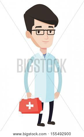 Young caucasian male doctor in medical gown holding first aid box. Friendly doctor in uniform standing with first aid kit. Vector flat design illustration isolated on blue background. Square layout.