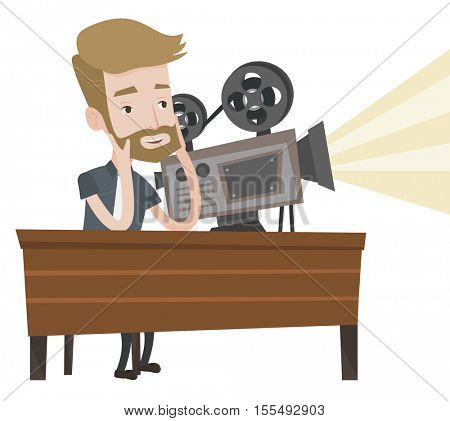 Hipster man with beard sitting near a film projector at the table. Caucasian projectionist showing new film. Young projectionist at work. Vector flat design illustration isolated on white background.
