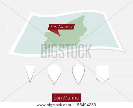 Curved Paper Map Of San Marino With Capital San Marino On Gray Background. Four Different Map Pin Se