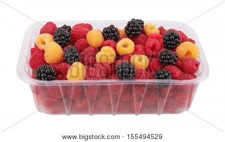 Blackberry, red and yellow raspberry in package, isolated on white background