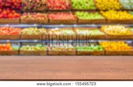 Wooden Empty Table In Front Of Blurred Supermarket Fruits Shelf