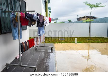 Hanging wet clothes at rainy monsoon season in South East Asia