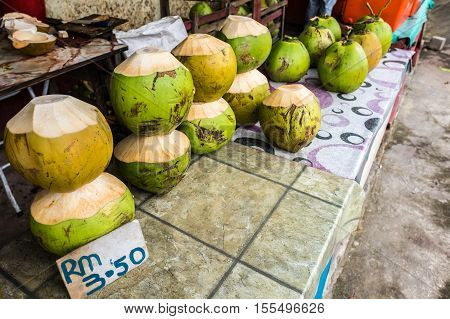 Fresh coconuts being sold at roadside stall in Borneo
